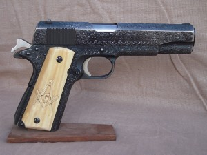 A 1911 Colt with ivory grips craved with a Masonic Symbol.