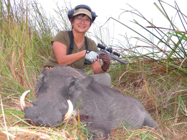 Il Ling New and a good warthog taken with her Ruger Super Redhawk Sheriff Jim Wilson