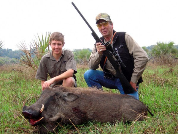 A warthog taken for camp meet with a Rem. 700, in .223. With me is Nicholas Hamman, the PH's son.