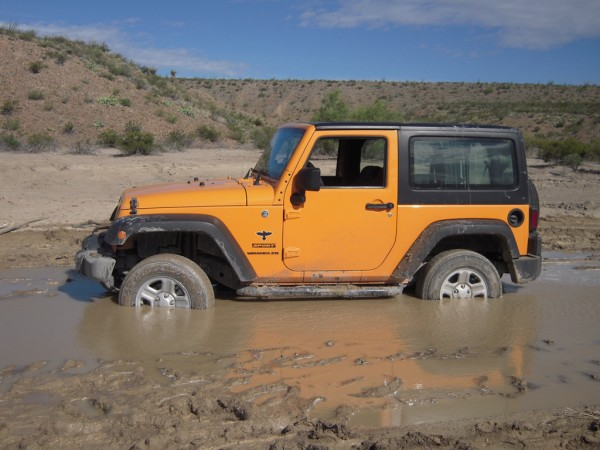 Sheriff Jim Wilson proves that you actually can get a Jeep stuck in the mud.